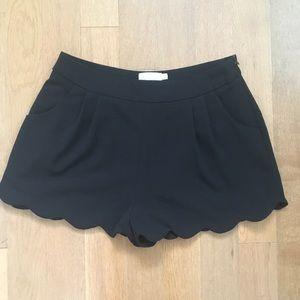 LUSH scalloped hem black shorts